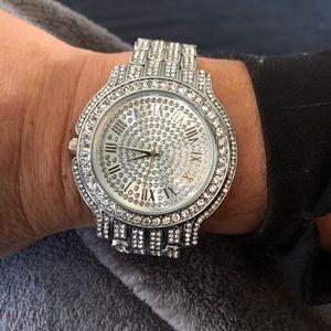 Fashion watch silver with faux diamonds.